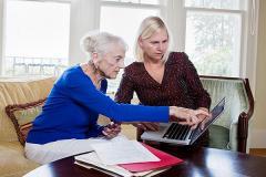 100606904-elderly_woman_financial_advisor_gettyp.240x160