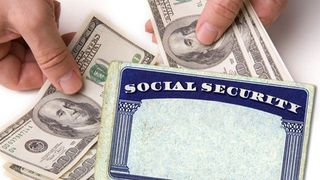 Social-Security-Card-With-Cash-in-Hands
