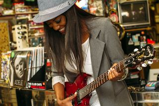 Womanwithguitarphoto-1436831135709-48bdc150cce5